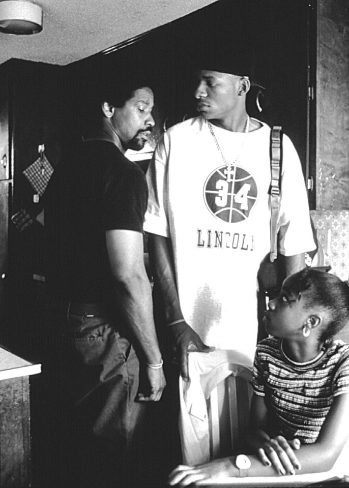 "Unexpectedly re-entering his children's lives after a lengthy absence, Jake Shuttlesworth (Denzel Washington), left, confronts his angry son Jesus (Ray Allen), center, and caring daughter Mary (Zelda Harris) in ""He Got Game."""