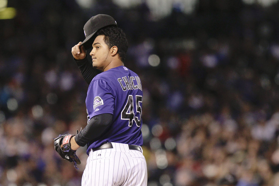 Photo -   Colorado Rockies starting pitcher Jhoulys Chacin (45) looks at Colorado Rockies manager Jim Tracy as he comes to remove him from the game after giving up seven runs to the Los Angeles Dodgers in the fifth inning of a baseball game Tuesday, May 1, 2012 in Denver. The Dodgers won 7-6. (AP Photo/Barry Gutierrez)