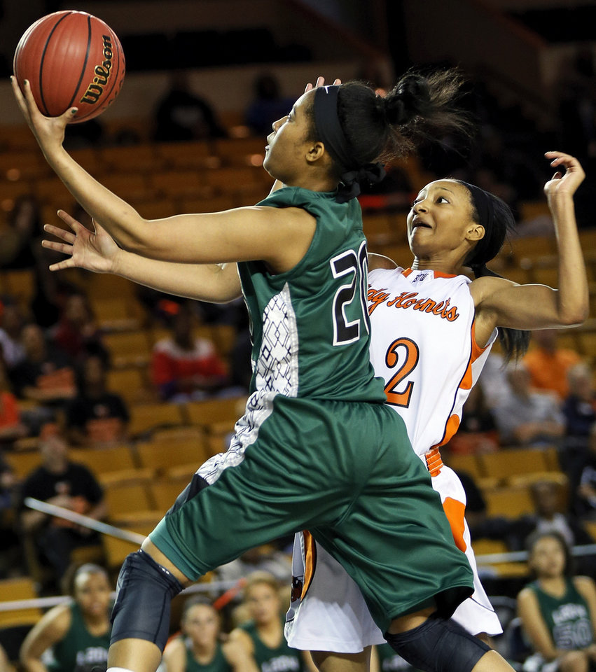 Photo - Edmond Santa Fe's Tamara Lee (20) takes the ball to the basket past Booker T. Washington's Kaylan Mayberry (12) during a Class 6A girls high school basketball game in the semifinals of the state tournament at the Mabee Center in Tulsa, Okla., Friday, March 8, 2013. Bookter T. Washington won, 72-70. Photo by Nate Billings, The Oklahoman