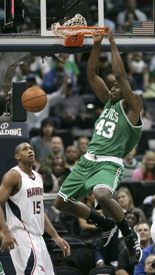 Boston Celtics' Kendrick Perkins (43) scores as Atlanta Hawks' Al Horford (15) looks on during the first quarter of an NBA basketball game Wednesday, Dec. 17, 2008, in Atlanta.  (AP Photo)