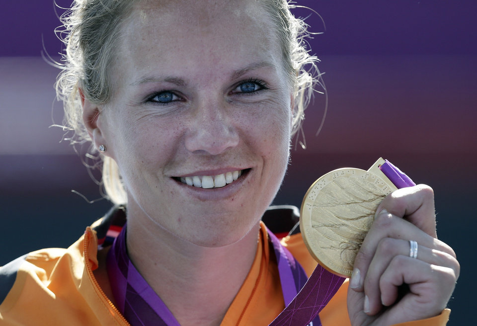 Photo -   Esther Vergeer of the Netherlands holds her gold medal for winning the women's wheelchair tennis final at the 2012 Paralympics games, Friday, Sept. 7, 2012, in London. Vergeer defeated Aniek Van Koot in the final 6-0, 6-4.(AP Photo/Alastair Grant)