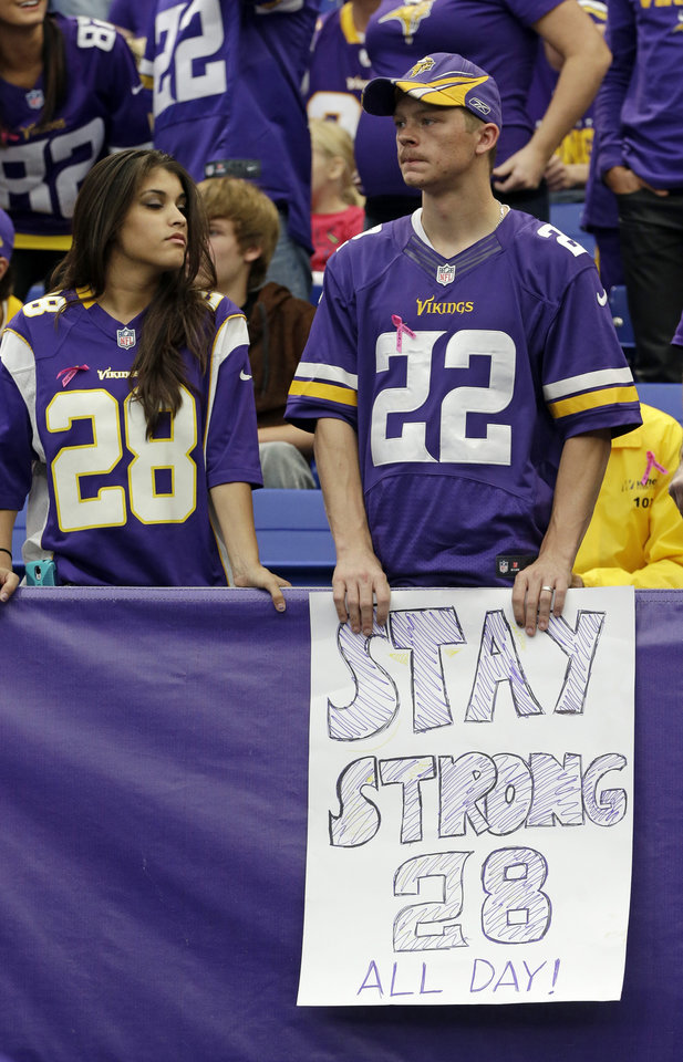 Photo - Minnesota Vikings fans hold a sign supporting Vikings running back Adrian Peterson during the second half of an NFL football game in Minneapolis, Sunday, Oct. 13, 2013. One of the star running back's sons, a 2-year-old in South Dakota, died Friday after an alleged attack in a child abuse case.  The Carolina Panthers defeated the Vikings 35-10. (AP Photo/Jim Mone)