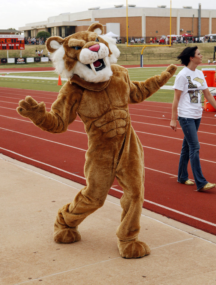 The Southmoore  Sabercats's mascot enters the field as they play the Westmoore Jaguars in high school football on Friday, Sept. 7, 2012, in Moore, Okla.  Photo by Steve Sisney, The Oklahoman