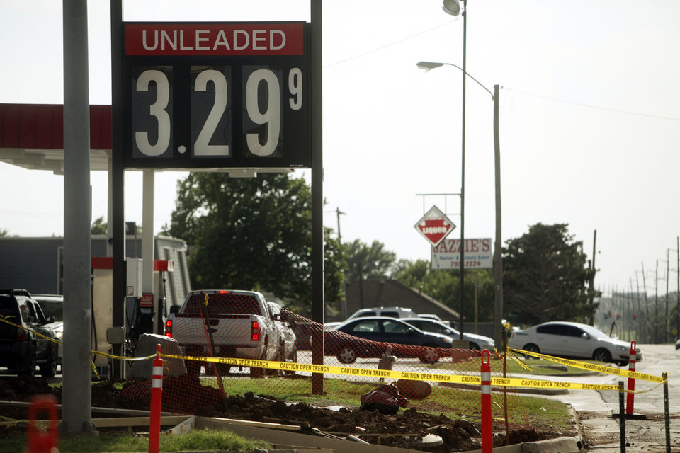 Photo - This gas price sign advertises $3.29-per-gallon unleaded on Tuesday in Oklahoma City .  KT King -  The Oklahoman
