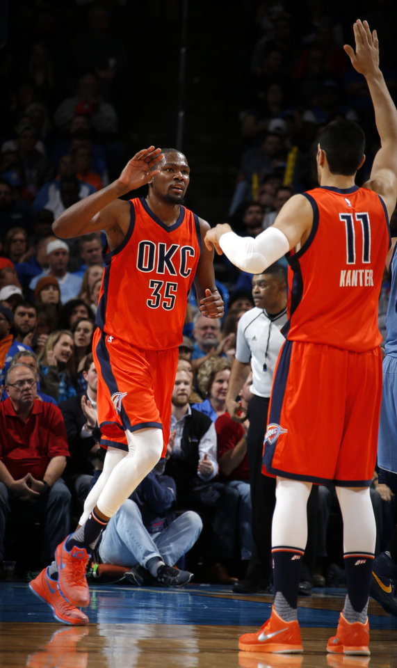 Photo - Oklahoma City's Kevin Durant celebrates eith Enes Kanter during an NBA basketball game between the Oklahoma City Thunder and the Memphis Grizzlies at Chesapeake Energy Arena in Oklahoma City, Wednesday, Jan. 6, 2016.  Photo by Bryan Terry, The Oklahoman