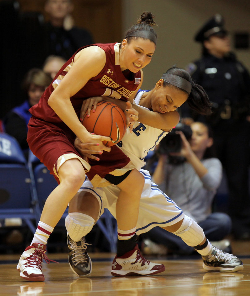 Photo - Duke's Chloe Wells, right, fights for a loose ball with Boston College's Lauren Engeln during the first half of an NCAA college basketball game in Durham, N.C., Sunday, Jan. 12, 2014. (AP Photo/Ted Richardson)