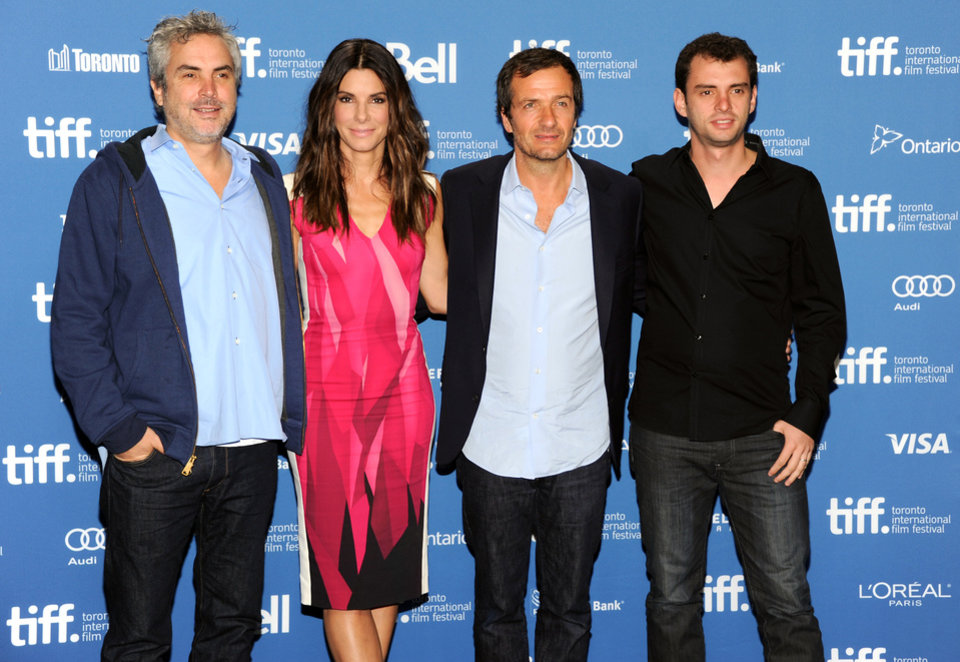 "Photo - Director Alfonso Cuaron, from left, actress Sandra Bullock, producer David Heyman and screenwriter Jonas Cuaron attend the press conference for ""Gravity"" on day 5 of the 2013 Toronto International Film Festival at the TIFF Bell Lightbox on Monday, Sept. 9, 2013 in Toronto. (Photo by Evan Agostini/Invision/AP) ORG XMIT: TOEA102"