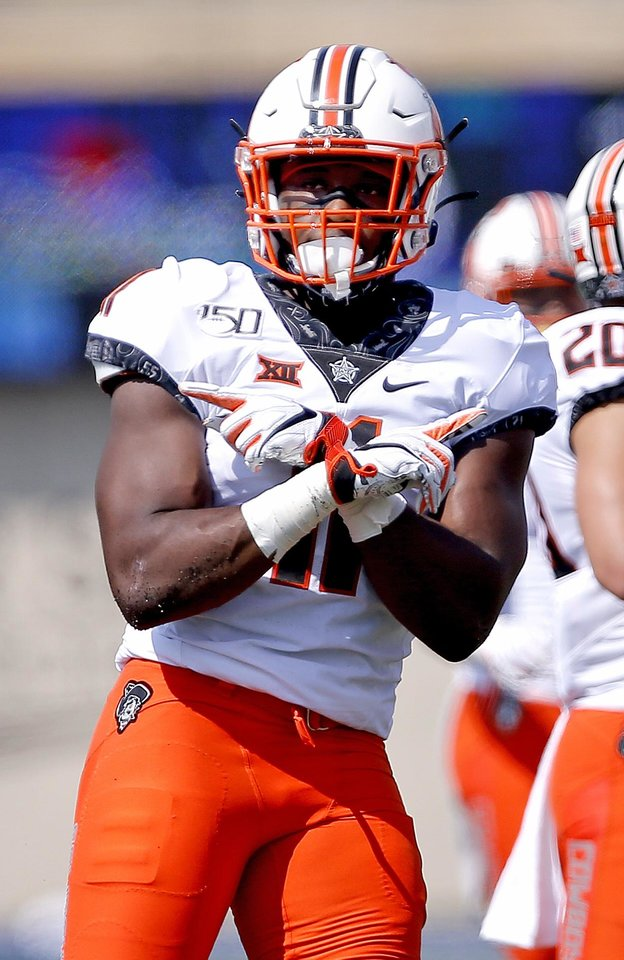 Photo - Oklahoma State's Amen Ogbongbemiga (11) celebrates a play in the first quarter during a college football game between the Oklahoma State University Cowboys (OSU) and the University of Tulsa Golden Hurricane (TU) at H.A. Chapman Stadium in Tulsa, Okla., Saturday, Sept. 14, 2019. [Sarah Phipps/The Oklahoman]