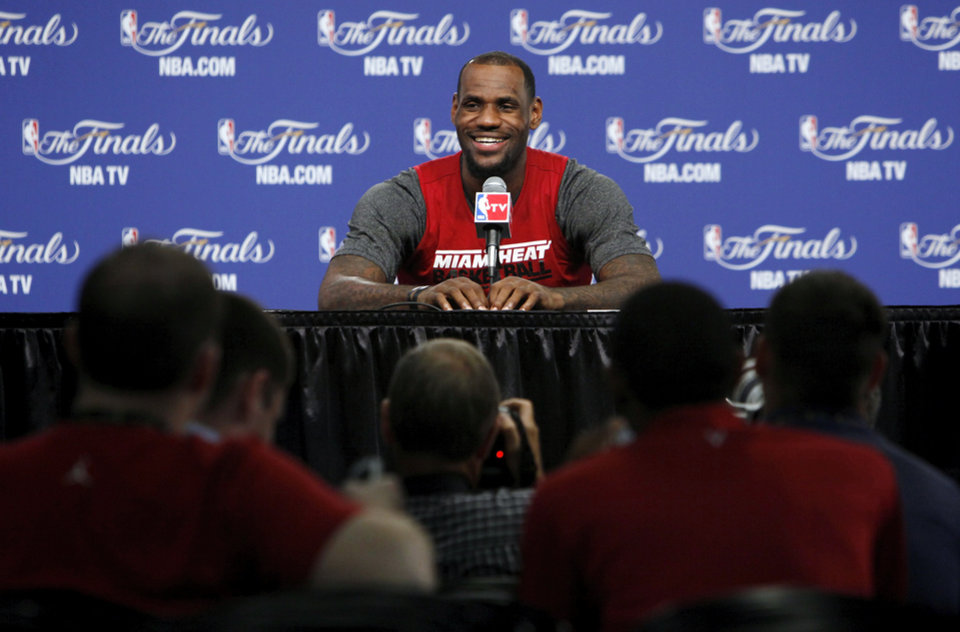 Miami\'s LeBron James answers a question during media and practice day for the NBA Finals between the Oklahoma City Thunder and the Miami Heat at the Chesapeake Energy Arena in Oklahoma City, Monday, June 11, 2012. Photo by Nate Billings, The Oklahoman
