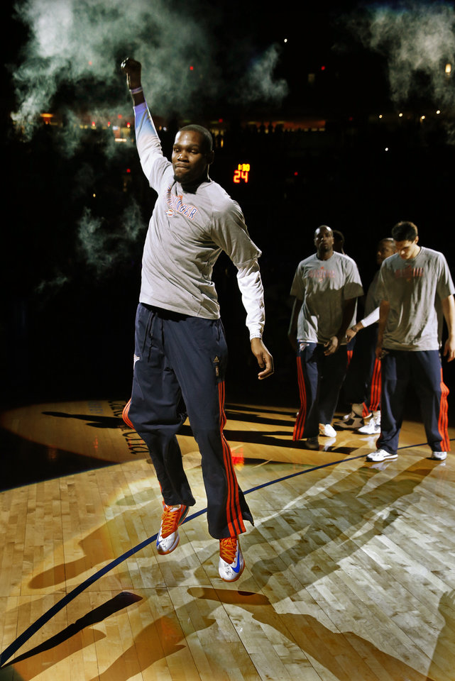 Photo - Oklahoma City Thunder's Kevin Durant isn introduced at an NBA basketball game where the Oklahoma City Thunder play the Los Angeles Lakers at the Chesapeake Energy Arena in Oklahoma City, on March 13, 2014. PHOTO BY STEVE SISNEY, The Oklahoman