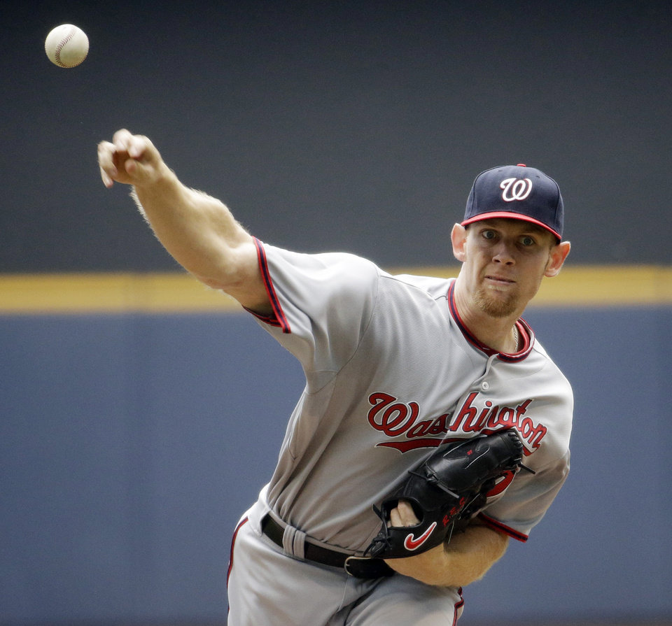 Photo - Washington Nationals starting pitcher Stephen Strasburg throws during the first inning of a baseball game against the Milwaukee Brewers Wednesday, June 25, 2014, in Milwaukee. (AP Photo/Morry Gash)