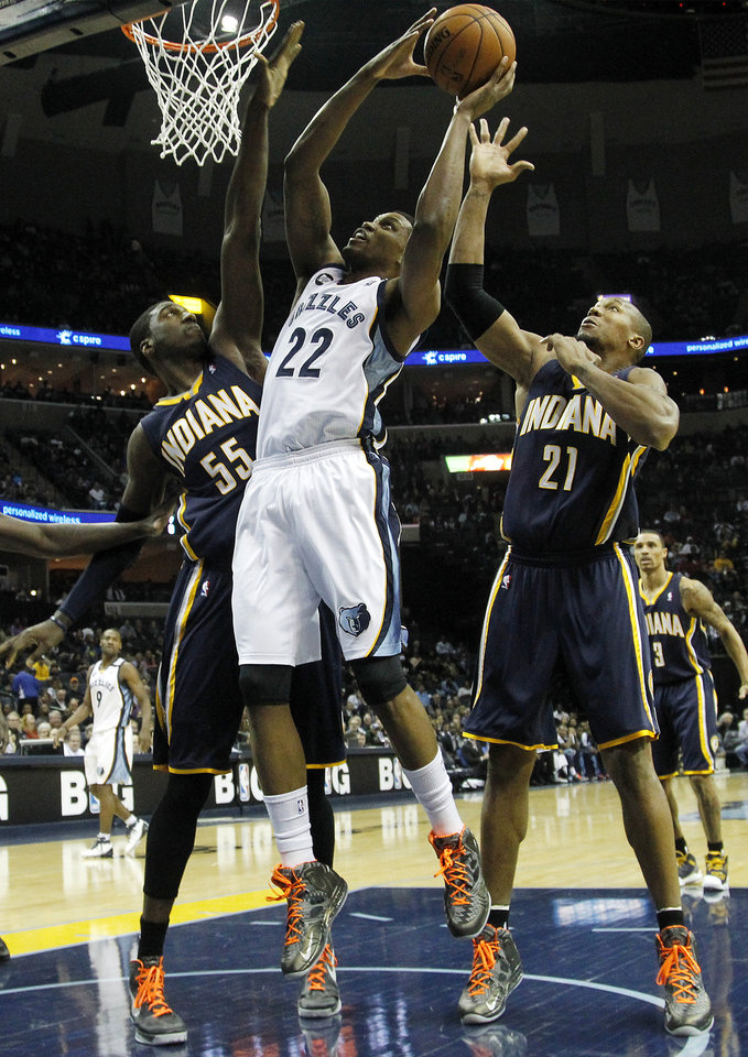 Memphis Grizzlies forward Rudy Gay (22) goes to the basket against Indiana Pacers center Roy Hibbert (55) and forward David West (21) in the first half of an NBA basketball game on Monday, Jan. 21, 2013, in Memphis, Tenn. (AP Photo/Lance Murphey)