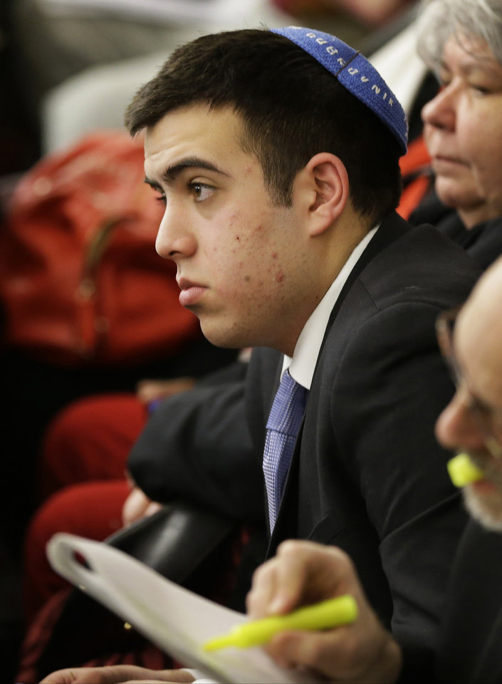 Sami Rahamim, a 17-year-old Minneapolis high school student who has embraced a public role speaking against gun violence in the months since his father and four others were slain last fall at the family business, listens during a Minnesota house committee hearing testimony at the State Capitol on two bills dealing with the gun violence issue Tuesday, Feb. 5, 2013 in St. Paul, Minn. Rahamim testified earlier Tuesday before the committee. (AP Photo/Jim Mone)