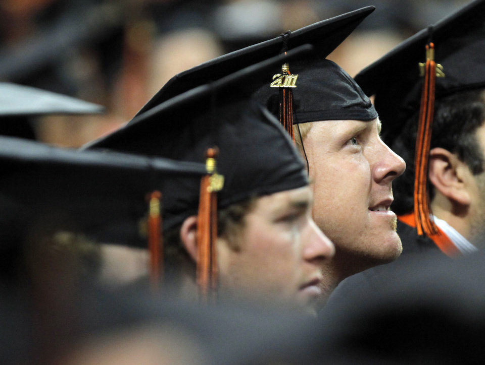 Photo - OSU quarterback and degree candidate Brandon Weeden listens during the 12:30 p.m. undergraduate commencement ceremony inside of Gallagher-Iba Arena at Oklahoma State University in Stillwater, Okla., Saturday, May 7, 2011. This was the second of three undergraduate commencement ceremonies at OSU on Saturday. Photo by Nate Billings, The Oklahoman ORG XMIT: KOD