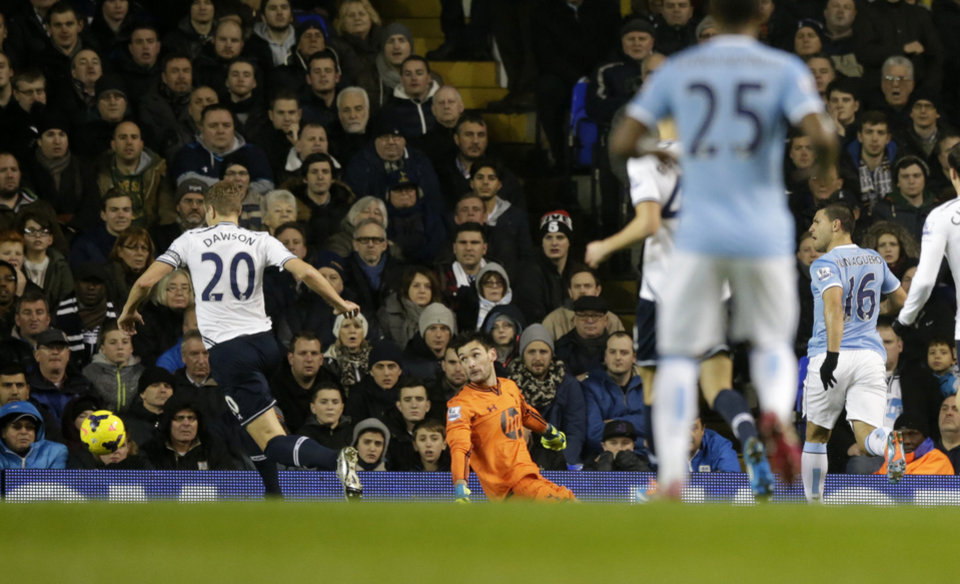 Photo - Manchester City's Sergio Aguero, right, scores during the English Premier League soccer match between Tottenham Hotspur and Manchester City at White Hart Lane stadium in London, Wednesday, Jan. 29, 2014.  (AP Photo/Matt Dunham)