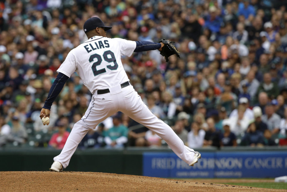 Photo - Seattle Mariners starting pitcher Roenis Elias throws against the Washington Nationals in the first inning of a baseball game, Saturday, Aug. 30, 2014, in Seattle. (AP Photo/Ted S. Warren)