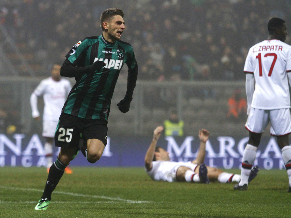 Photo - Sassuolo's Domenico Berardi celebrates after scoring his fourth goal, during a Serie A soccer match against Sassuolo, at Reggio Emilia's Mapei stadium, Italy, Sunday, Jan. 12, 2014. (AP Photo/Davide Spada, Lapresse)