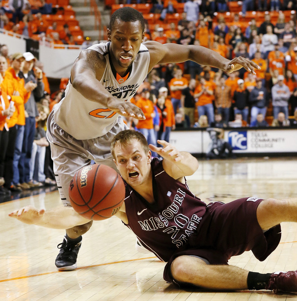 Photo - OSU's Kamari Murphy (21) and Nathan Scheer (30) of Missouri State chase the ball during a men's college basketball between Oklahoma State University and Missouri State at Gallagher-Iba Arena in Stillwater, Okla., Saturday, Dec. 8, 2012. OSU won, 62-42. Photo by Nate Billings, The Oklahoman
