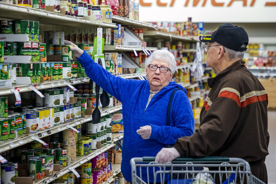 Photo - Customers Shirley and Charles Lee shop for items at the Homeland grocery store located at 11241 W. Reno Ave. in Yukon, Okla. on Thursday, March 19, 2020. Homeland has dedicated the first hour of store operations to senior customers and those who have medical conditions that put them at risk from COVID-19.  [Chris Landsberger/The Oklahoman]