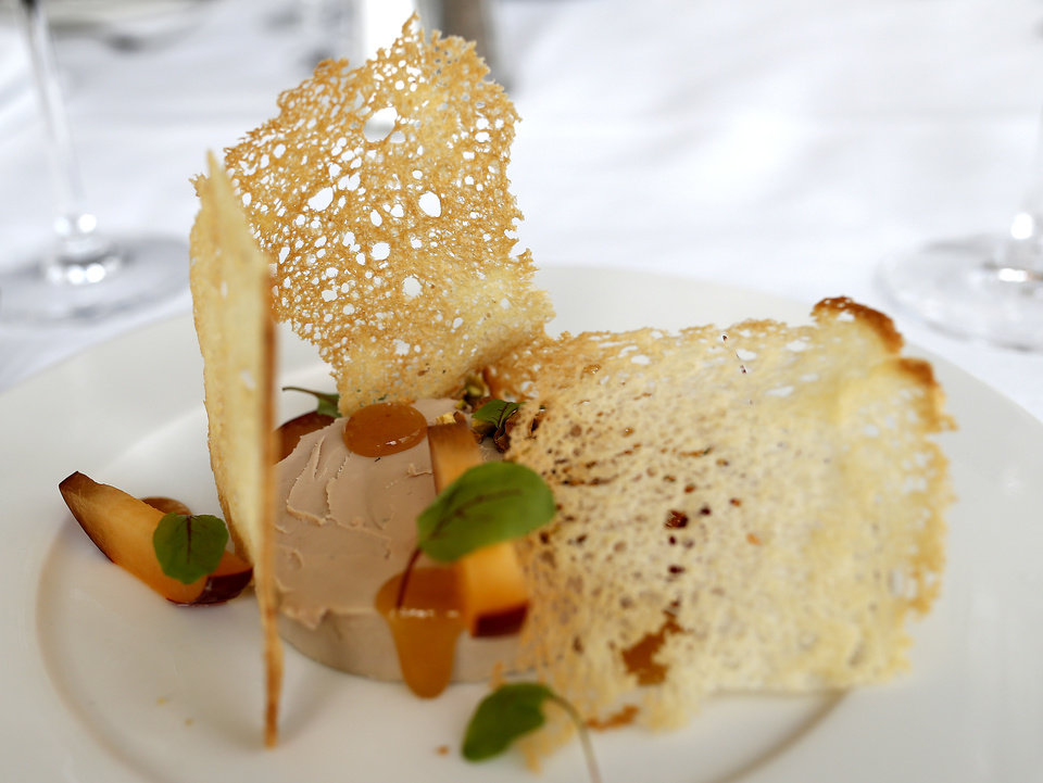 Photo - Foie gras with plum is pictured at the The George Prime Steakhouse in Oklahoma City, Thursday, June 20,  2014. Photo by Sarah Phipps, The Oklahoman