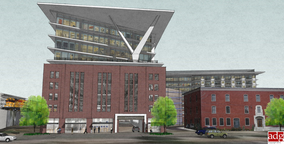 A new garage designed to resemble a Bricktown warehouse will front along Main Street just east of the BNSF Railway viaduct. This drawing shows how offices might look atop the south garage section, with potential housing atop the southern parking structure in the foreground. Drawing provided by ADG Inc.
