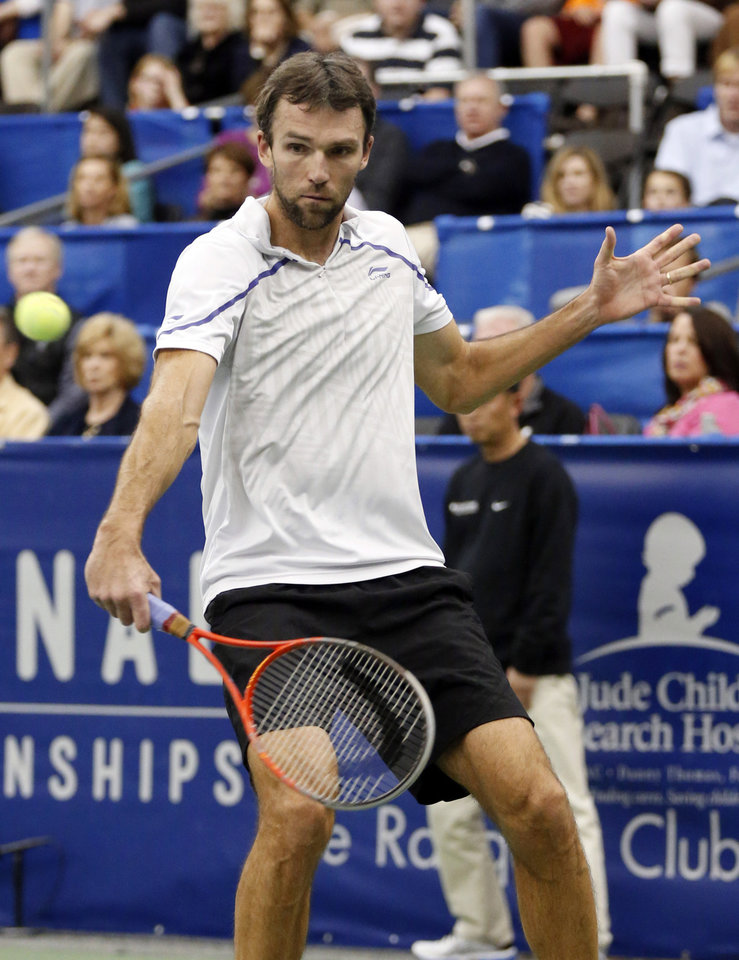 Photo - Ivo Karlovic, of Croatia, hits a return to Kei Nishikori, of Japan, in the singles final at the U.S. National Indoor Tennis Championships on Sunday, Feb. 16, 2014, in Memphis, Tenn. (AP Photo/Rogelio V. Solis)