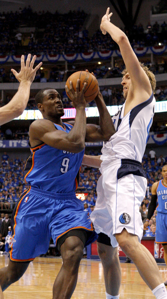 Photo - Oklahoma City's Serge Ibaka (9) tries to get past Dirk Nowitzki (41) of Dallas  during game 1 of the Western Conference Finals in the NBA basketball playoffs between the Dallas Mavericks and the Oklahoma City Thunder at American Airlines Center in Dallas, Tuesday, May 17, 2011. Photo by Bryan Terry, The Oklahoman