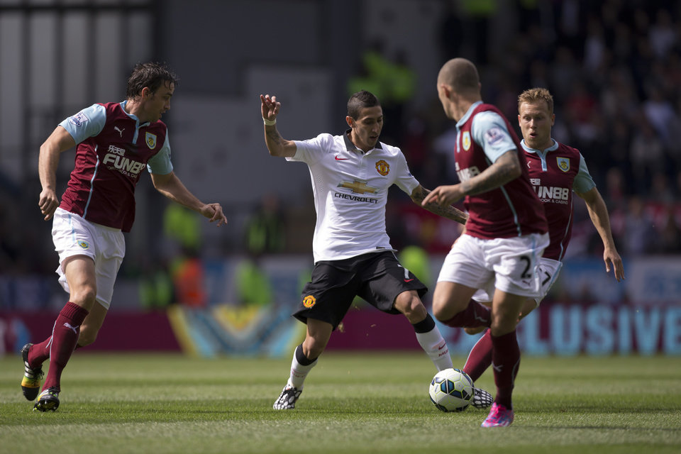 Photo - Manchester United's Angel Di Maria, center, attempts to beat the Burnley defence during their English Premier League soccer match at Turf Moor Stadium, Burnley, England, Saturday Aug. 30, 2014. (AP Photo/Jon Super)