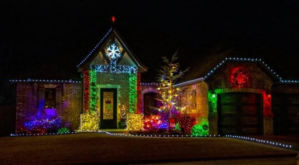 Photo -  Christmas lights decorate the house at 108 SW 175 Terrace. [CHRIS LANDSBERGER/THE OKLAHOMAN]