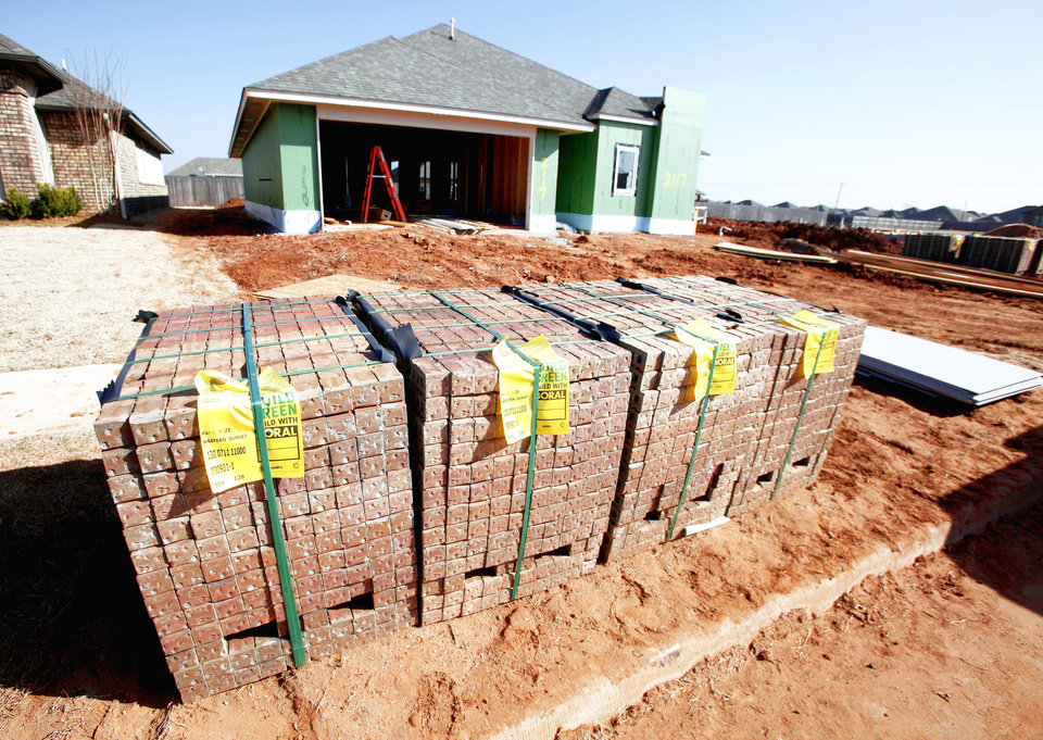 Photo - A home by Jeff Click Homes, one of Click's new, smaller Urbana series, stands ready for brick at 2117 NW 172 in the Silverhawk addition. Photo by PAUL B. SOUTHERLAND, THE OKLAHOMAN