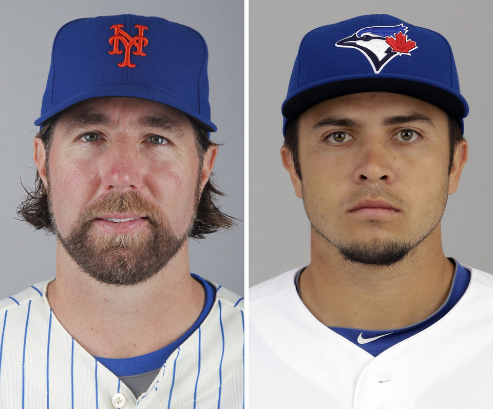 Photo - FILE - From left are 2012 file photos showing New York Mets' R.A. Dickey and Toronto Blue Jays' Travis d'Arnaud. A person familiar with the deal tells The Associated Press that Dickey and the Blue Jays have agreed on a new contract, clearing the way for the New York Mets to trade the Cy Young winner to Toronto. The person spoke on condition of anonymity Monday, Dec. 17, 2012,  because the trade was not yet complete. The 38-year-old knuckleballer must pass a physical before he joins the Blue Jays. The Mets would get prized catching prospect Travis d'Arnaud as the centerpiece of the multiplayer swap. (AP Photo/File)