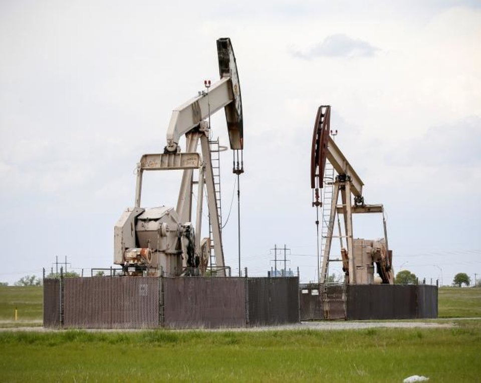 Photo -  Pump jacks produce oil from an Oklahoma City-area field. Energy companies, especially ones exposed to commodity prices, haven't been attractive options for investors, 2020 Oklahoma Inc. reports. [THE OKLAHOMAN ARCHIVES]