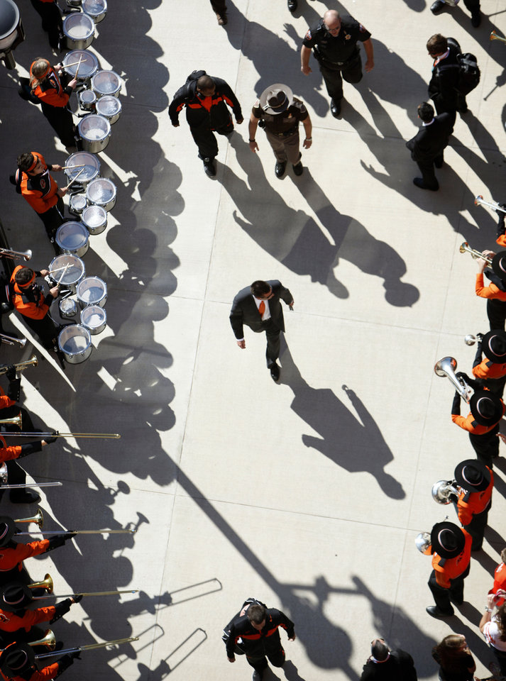 Oklahoma State head coach Mike Gundy enters the stadium during the Spirit Walk before a college football game between the Oklahoma State University Cowboys (OSU) and the Baylor University Bears (BU) at Boone Pickens Stadium in Stillwater, Okla., Saturday, Oct. 29, 2011. Photo by Sarah Phipps, The Oklahoman