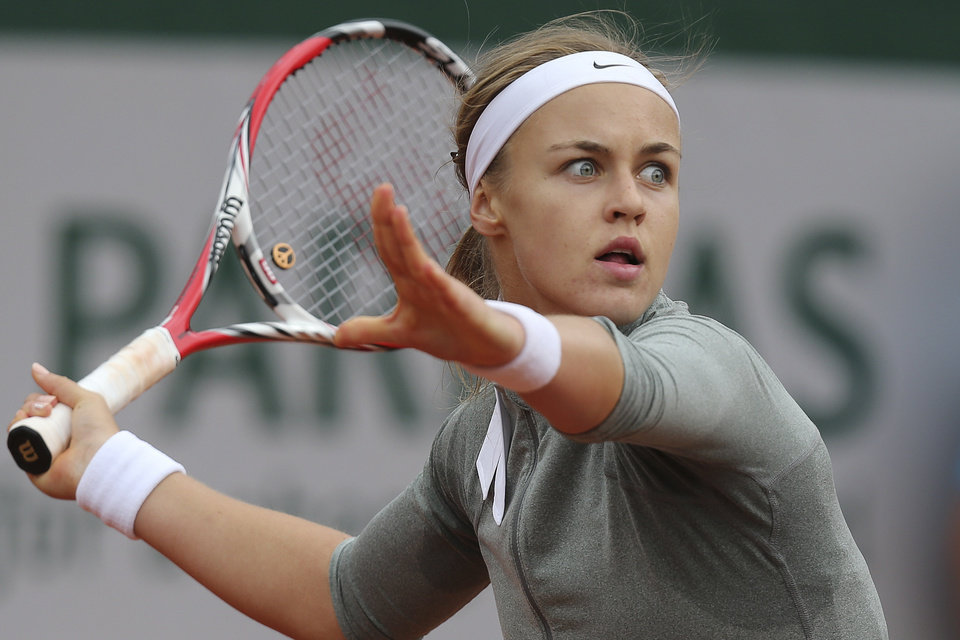 Photo - Slovakia's Anna Schmiedlova returns the ball during the second round match of the French Open tennis tournament against Venus Williams of the U.S. at the Roland Garros stadium, in Paris, France, Wednesday, May 28, 2014. (AP Photo/David Vincent)