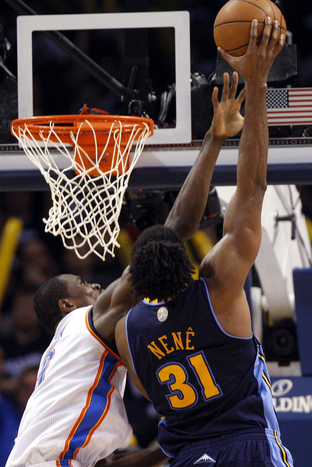 Photo - Oklahoma City's Serge Ibaka (9) blocks Denver's Nene's (31) layup with 3:31minutes left on the clock during the NBA basketball game between the Denver Nuggets and the Oklahoma City Thunder in the first round of the NBA playoffs at the Oklahoma City Arena, Wednesday, April 27, 2011. Photo by Sarah Phipps, The Oklahoman