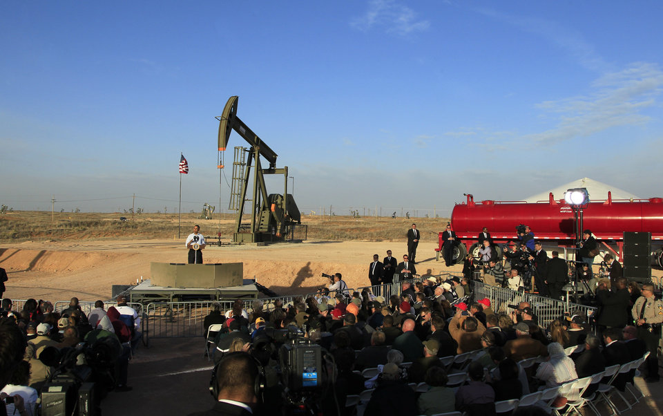 Photo - FILE - In this March 21, 2012, file photo, with oil pump jacks as a backdrop, President Barack Obama speaks at an oil and gas field on federal lands in Maljamar, N.M. The government has failed to inspect thousands of oil and gas wells it considers potentially high risks for water contamination and other environmental damage, congressional investigators say. The report, obtained by The Associated Press before its public release, highlights substantial gaps in oversight by the agency that manages oil and gas development on federal and Indian lands. (AP Photo/Ross D. Franklin, File)