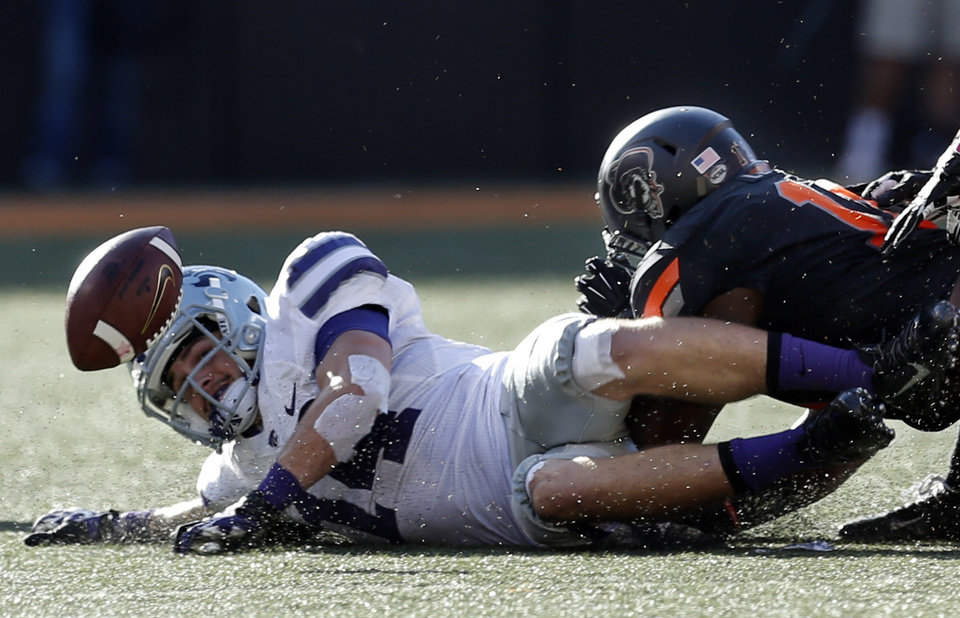 Oklahoma State's Shaun Lewis (11) forces Kansas State's Curry Sexton (14) to fumble out of bounds in the third quarter during the second half of a college football game between the Oklahoma State University Cowboys (OSU) and the Kansas State University Wildcats (KSU) at Boone Pickens Stadium in Stillwater, Okla., Saturday, Oct. 5, 2013. OSU won 33-29.Photo by Sarah Phipps, The Oklahoman