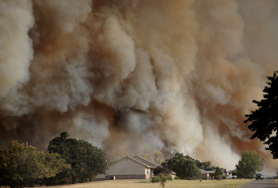 Smoke surrounds home in Luther, Okla.,  during a large wildfire Friday, Aug. 3, 2012. <strong>SARAH PHIPPS - THE OKLAHOMAN</strong>