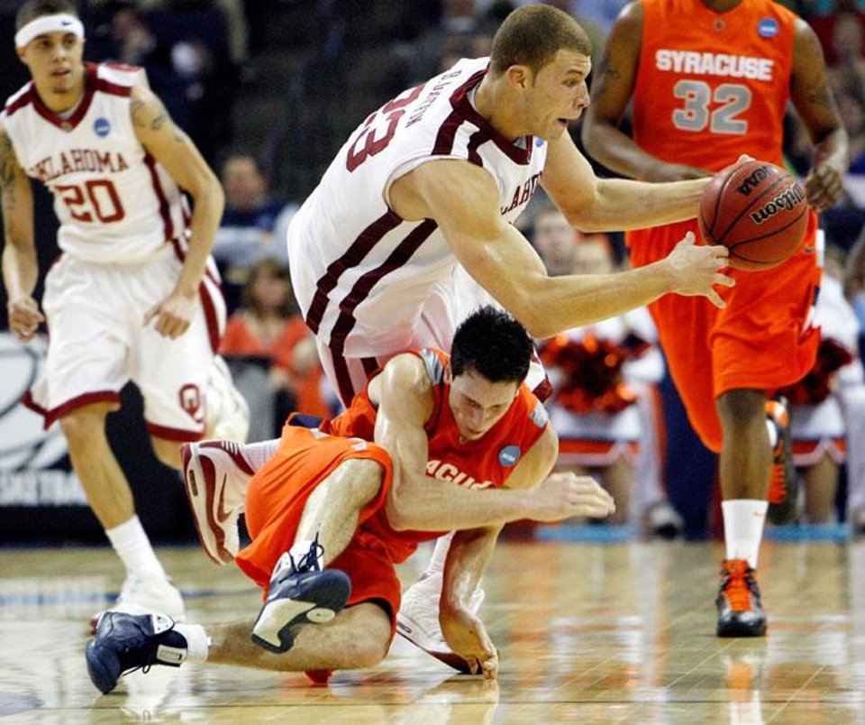 Photo -  Oklahoma's Blake Griffin (23) trips over Syracuse's Rautins (1) during the second half of the NCAA Men's Basketball Regional at the FedEx Forum on Friday, March 27, 2009, in Memphis, Tenn.  PHOTO BY CHRIS LANDSBERGER, THE OKLAHOMAN