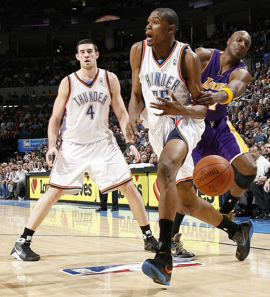 Oklahoma City's Kevin Durant is fouled by Lamar Odom of the Lakers as Nick Collison watches during the NBA basketball game between the Los Angeles Lakers and the Oklahoma City Thunder at the Ford Center,Tuesday, Feb. 24, 2009. PHOTO BY BRYAN TERRY, THE OKLAHOMAN