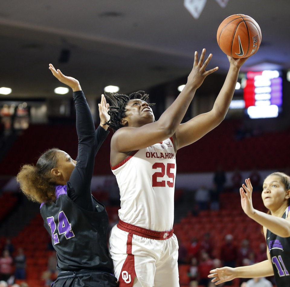 Photo - Oklahoma's Madi Williams (25) goes past Central Arkansas' Alanie Fisher (24) during an NCAA women's basketball game between the University of Oklahoma (OU) and Central Arkansas at Loyd Noble Center in Norman, Okla., Wednesday, Dec. 5, 2018. Photo by Bryan Terry, The Oklahoman