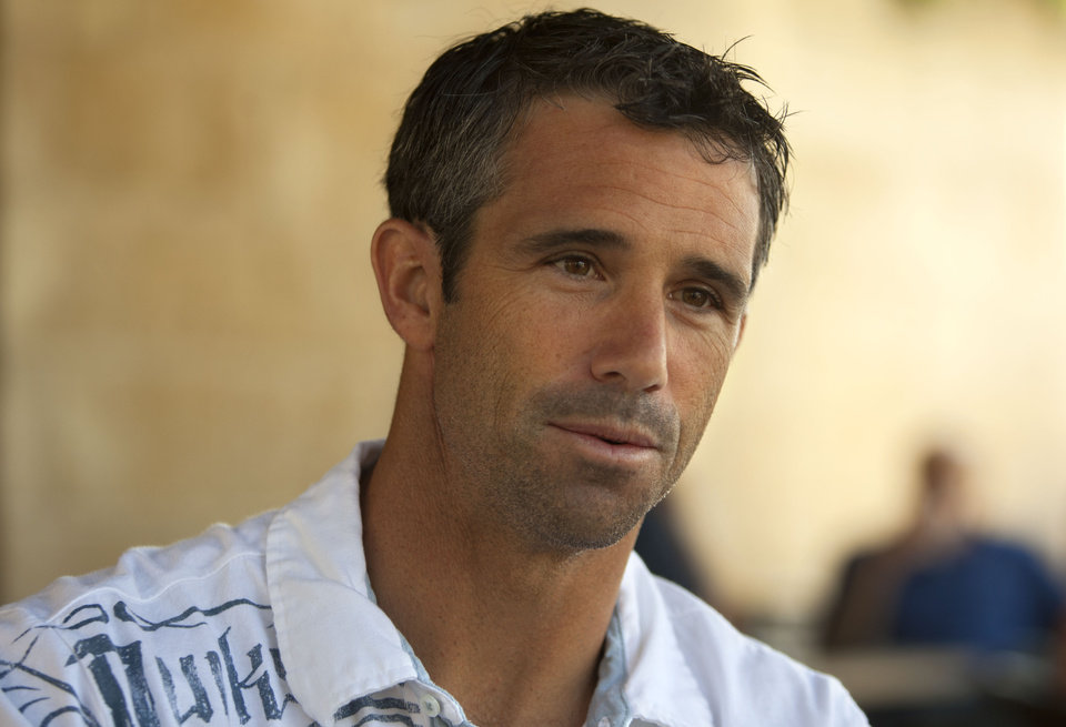 Photo -   Former professional baseball player Brad Ausmus speaks during an interview with the Associated Press, Monday, May 21, 2012, in Jerusalem. With a pair of Jewish ex-major leaguers on his roster, Ausmus, the new coach of Israel's team in next year's World Baseball Classic, says his squad is already a legitimate contender. (AP Photo/Sebastian Scheiner)