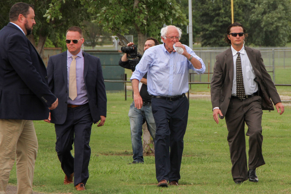 Photo - Democratic presidential candidate and Vermont Senator Bernie Sanders drinks a bottle of water as he heads to the car after the rally at Reaves Park in Norman, Oklahoma Sept. 22, 2019 [Paxson Haws/The Oklahoman]