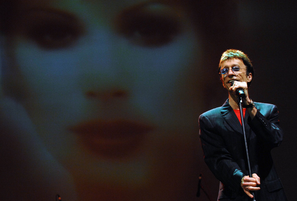 Photo -   FILE - In this March 1, 2008, file photo, musician Robin Gibb performs at the Dubai International Jazz Festival in Dubai Media City Amphitheater, Dubai, United Arab Emirates. A representative said on Sunday, May 20, 2012, that Gibb has died at the age of 62. (AP Photo/Tracy Brand, File)