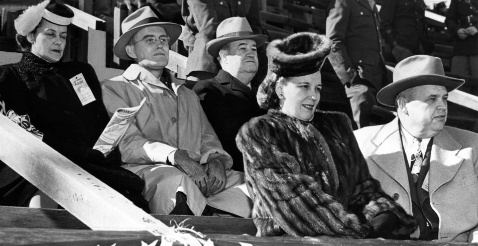 ROBERT S KERR / GOVERNOR / OKLAHOMA / OKLAHOMA A&M / OU: The Sooners even joined hands with the Aggies in cheering for the Oklahoma A. and M. college football team as it pasted a 34-0 defeat on TCU in Monday\'s Cotton Bowl game in Dallas. Left to right are Mrs. George Cross and President Cross of the University of Oklahoma; Dr. Henry G. Bennett, president of A. and M. and Mrs. Robert Kerr and the Oklahoma chief executive (Robert S. Kerr).