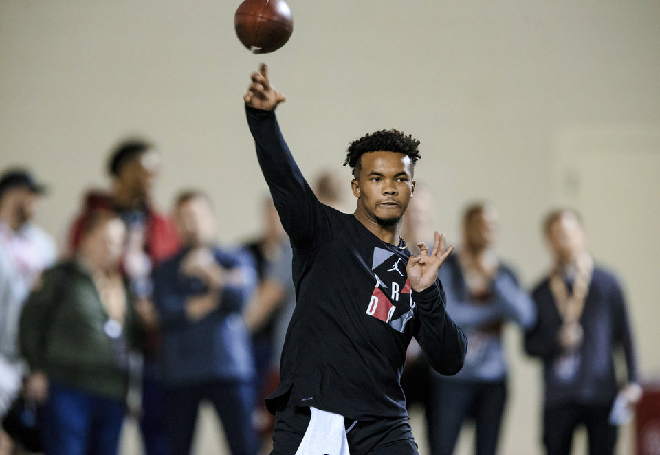 Photo - Kyler Murray throws the ball as he works out for NFL scouts during the University of Oklahoma football pro day at the University of Oklahoma in Norman, Okla. on Wednesday, March 13, 2019.   Photo by Chris Landsberger, The Oklahoman