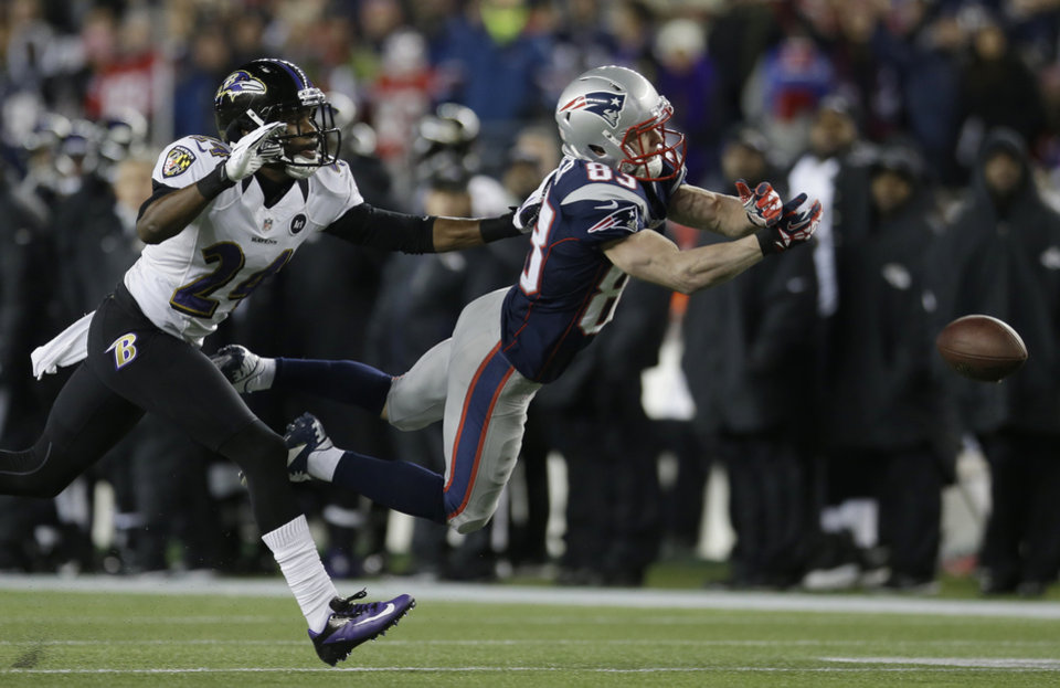 Photo - New England Patriots wide receiver Wes Welker (83) dives while being defended by Baltimore Ravens cornerback Corey Graham (24) during the first half of the NFL football AFC Championship football game in Foxborough, Mass., Sunday, Jan. 20, 2013. The pass was incomplete. (AP Photo/Elise Amendola)