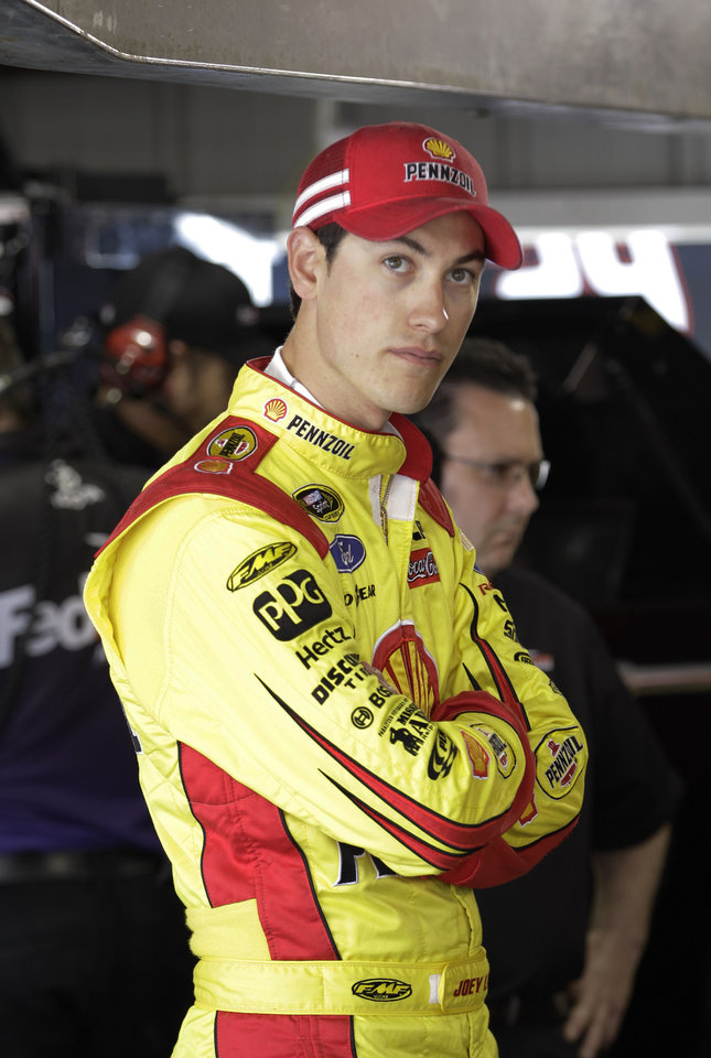 Photo - Driver Joey Logano waits in the garage during practice for Sunday's NASCAR Sprint Cup auto race at Martinsville Speedway in Martinsville, Va., Friday, April 5, 2013. (AP Photo/Steve Helber)