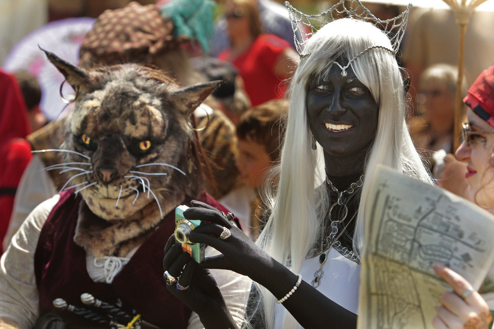 Stefany Belisle, dressed as a cat, and Cari Elliott, portraying a dark elf, wait for their category in a costume contest at last year's Medieval Fair in Norman.