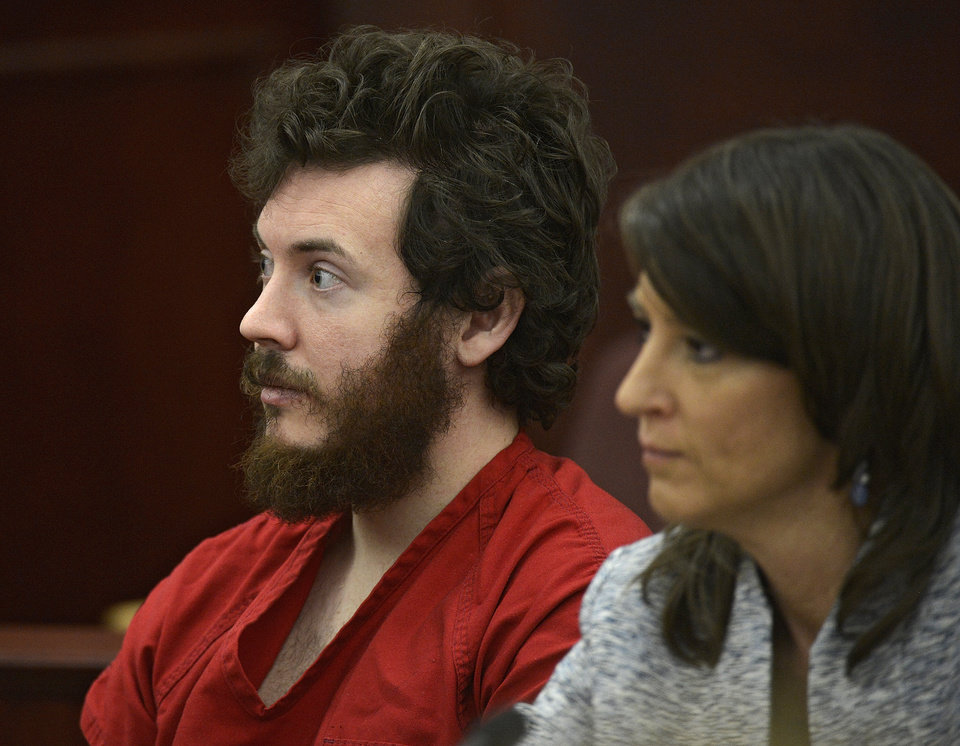 Photo - FILE - In this March 12, 2013 file photo, James Holmes, left, and defense attorney Tamara Brady appear in district court in Centennial, Colo. for his arraignment. Lawyers for Holmes, the man accused of killing 12 people and injuring 70 in a Colorado movie theater, said Tuesday May 7, 2013 he wants to change his plea to not guilty by reason of insanity. (AP Photo/The Denver Post, RJ Sangosti, Pool, File)